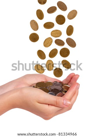 Female hands and falling coins  isolated on white background - stock photo