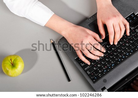 female hands are working on modern laptop, view from above - stock photo