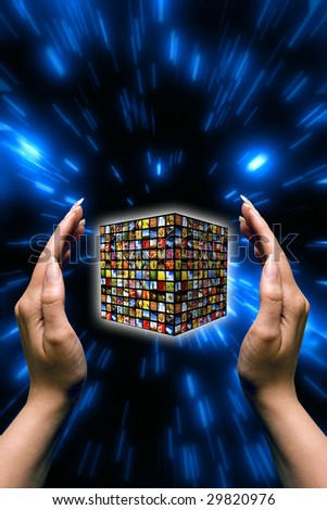 female hands around a cube with many images, concept for digital and internet television
