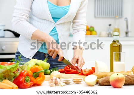 Female hands cooking healthy dinner at kitchen - stock photo