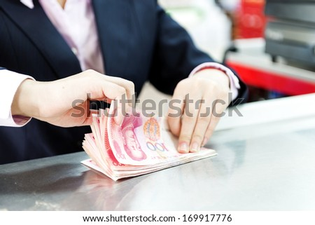 Female hands counting money - stock photo