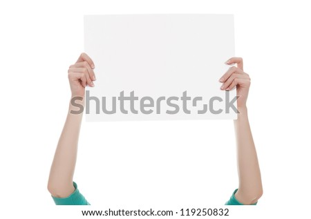 Female hands holding a blank white paper isolated over white background - stock photo
