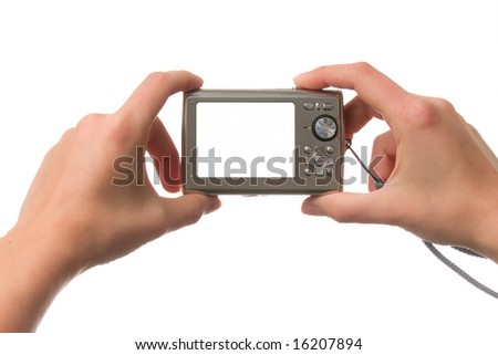 Female hands holding a compact camera over white - stock photo