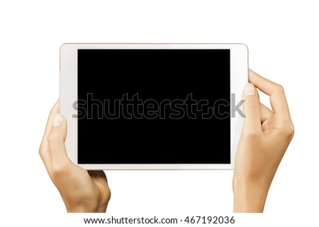 Female hands holding horizontal white tablet with black screen isolated at white background.