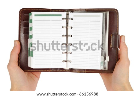Female hands holding leather notebook isolated with clipping path over white background - stock photo