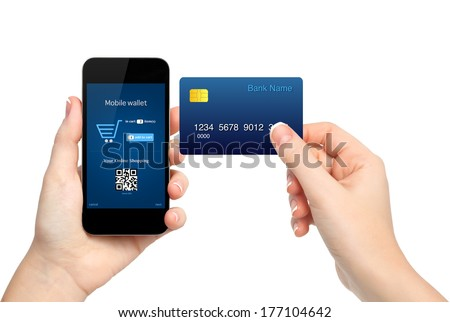 female hands holding phone and credit card making a purchase onlain
