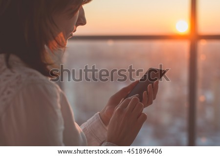 female hands holding smartphone, typing, using touchscreen and wi-fi internet - stock photo