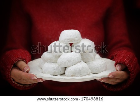 Female hands holding traditional Greek butter cookies - stock photo