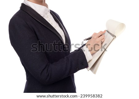 Female Hands In A Business Suit Holding A Pen Writing A Text - stock photo