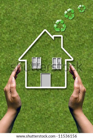 female hands in protecting gesture around a house icon with green recycling symbols coming out of chimney