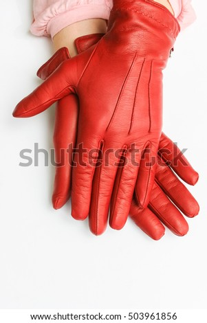 female hands in red gloves