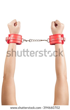 female hands in red leather handcuffs - stock photo