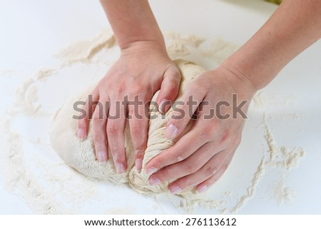 Female Hands Kneading Dough for baking .Homemade Preparing Food. - stock photo