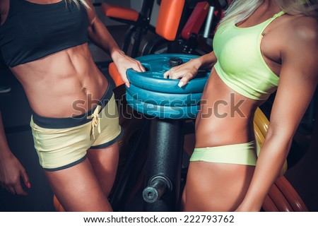female hands on athletic barbell  - stock photo