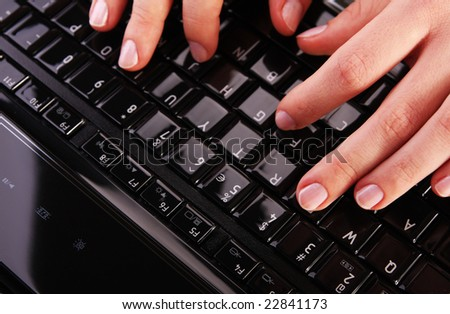 Female hands on laptop