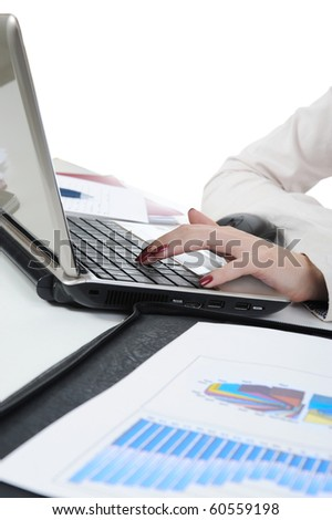 female hands on the laptop. Isolated on white background
