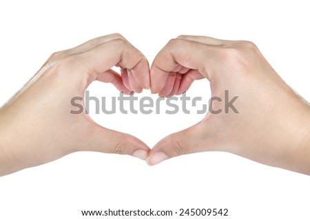 Female hands shaping a heart symbol  - stock photo