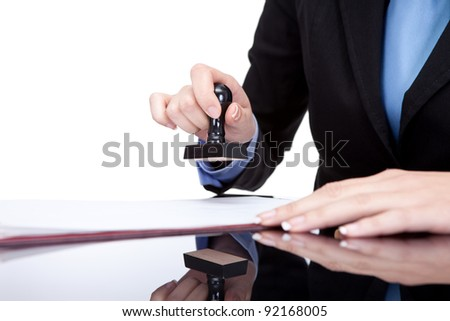 female hands stamping document in office, close up - stock photo