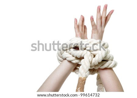 female hands tied up with rope over white - stock photo