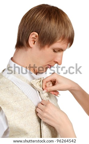 Female hands to tie a tie; Girl helps man to dress holiday suit isolated on white background