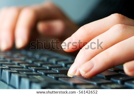 Female hands typing. - stock photo