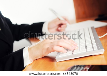 Female hands typing on a keyboard
