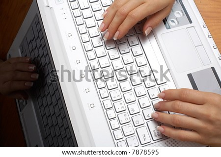 Female hands typing on the keyboard of a laptop