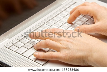 Female hands using computer