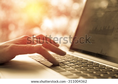 female hands using computer laptop. Vintage filter - stock photo