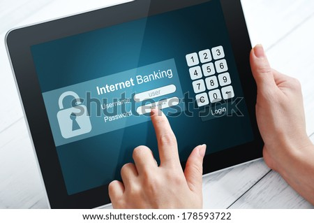 Female hands using internet banking on  tablet pc  - stock photo