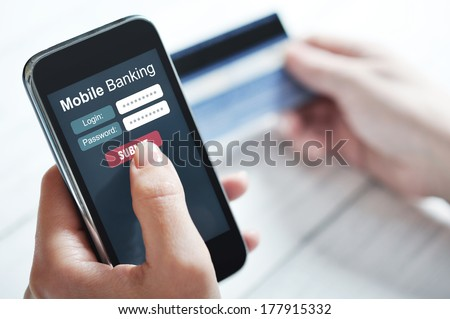 Female hands using mobile banking on smart phone - stock photo