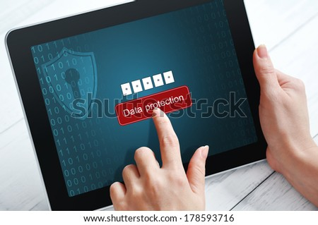 Female hands using tablet pc protected with password - stock photo