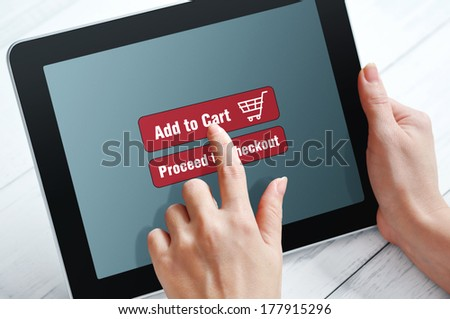 Female hands using touch screen device for online shopping  - stock photo