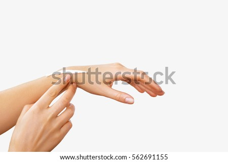 Female hands with a moisturiser on light background. Close-up of Woman Applying Cream on Hand. Hands Skin Care.