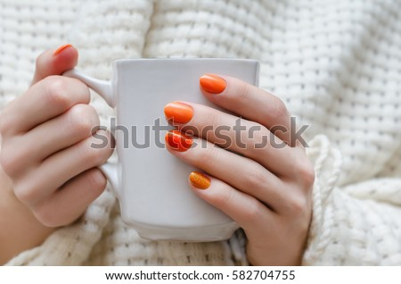 Female hands orange nail design holding stock photo 582704755 female hands with orange nail design holding white cup prinsesfo Choice Image