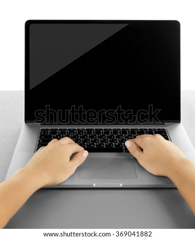 Female hands working on laptop, isolated on white
