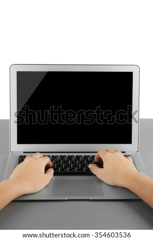 Female hands working on laptop, on light background