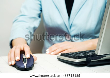 Female hands working on the computer. - stock photo