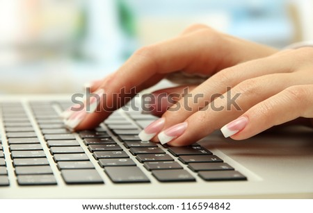 female hands writing on laptot, close up - stock photo