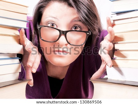 Female have The confusion between the book. Selective focus on the female - stock photo