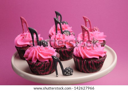 Female high heel shoes decorated pink and black red velvet cupcakes with high heel shoes for teenage, female birthday, or wedding bridal shower - stock photo