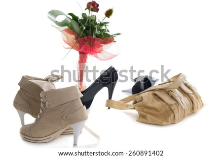 Female high heels shoes with woman bag and flowers- Front and Side View  - stock photo