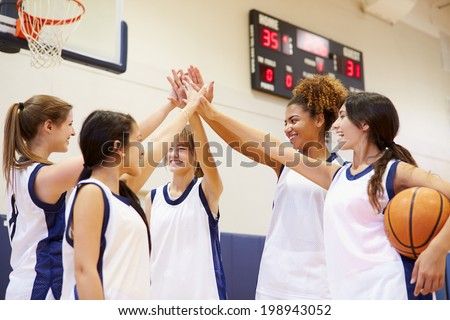 Female High School Basketball Team Having Team Talk - stock photo