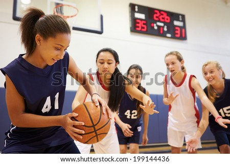 Female High School Basketball Team Playing Game - stock photo