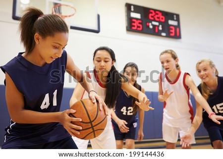 Female High School Basketball Team Playing Game - stock photo