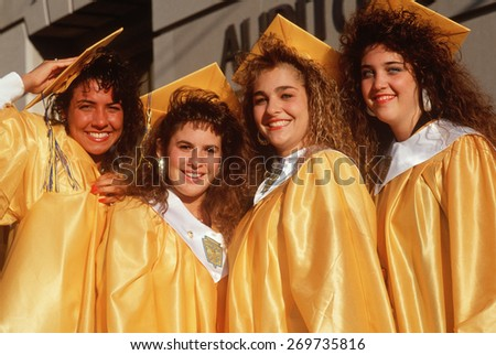 Female high school graduates, Providence, Rhode Island - stock photo
