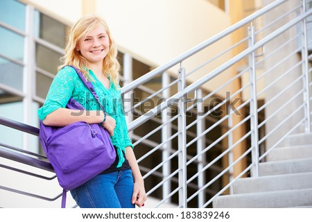 Female High School Student Standing Outside Building - stock photo