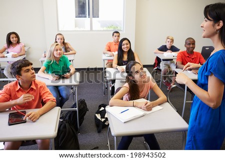 Female High School Teacher Taking Class - stock photo