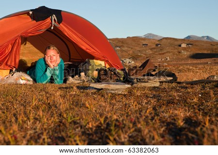 Female Hiker in a Tent - stock photo