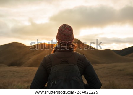 Female hiker looking out into the horizon.  - stock photo